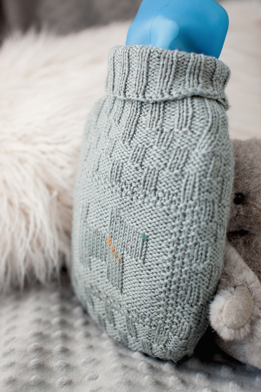 Best Friend Hot Water Bottle Cover, in One-Skein Wonders for Babies from @storeypub; knitting pattern by Kendra Nitta, photo copyright geneve hoffmann photography, used with permission