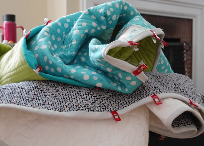 Pile of quilts to bind from missknitta.com