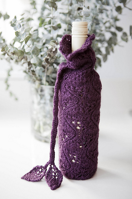 Lace Bottle Cozy from Lace One-Skein Wonders from @storeypub; knitting pattern by Kendra Nitta, photo copyright geneve hoffmann photography, used with permission