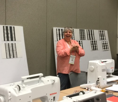 Jacquie Gering at #QuiltCon2016 teaching #activatingspacequilt class